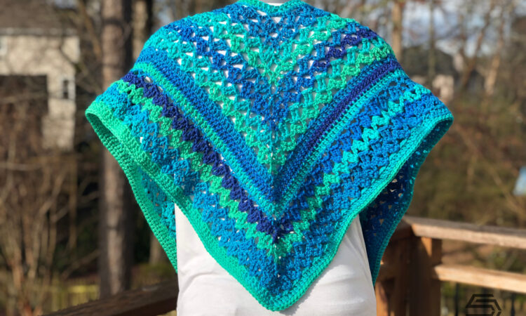 The Cascading Waterfall Wrap is an intermediate crochet pattern that uses less than 550 yards of worsted weight yarn.