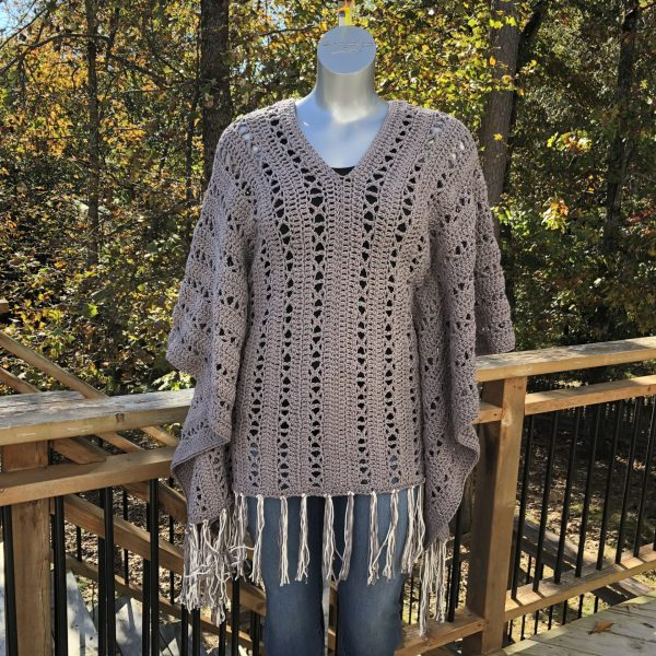 X-capade Poncho, a crochet pattern using worsted weight weight. It'll become your favorite poncho to wear no matter the weather.
