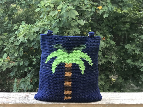 The Palm Tree Tapestry Bag carries a bit of summer wherever you may go. It's a great project for practicing tapestry with options to personalize the handles and bottom.