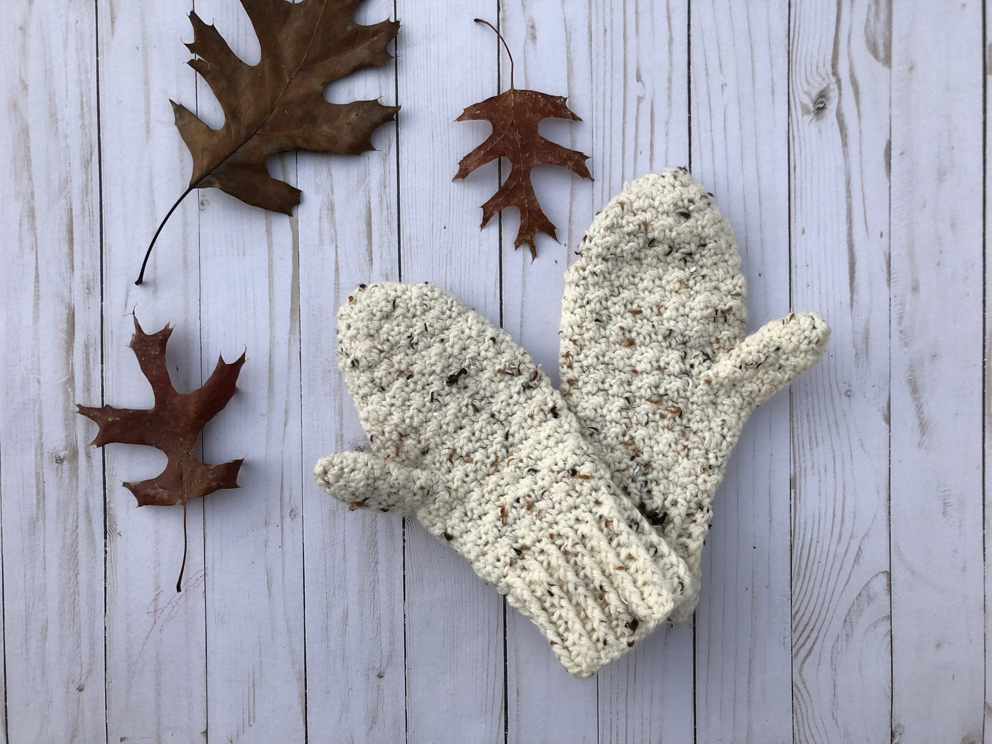 The Lemon Peel Mittens offer textured stitches, a shaped thumb, and ribbing at the wrist.