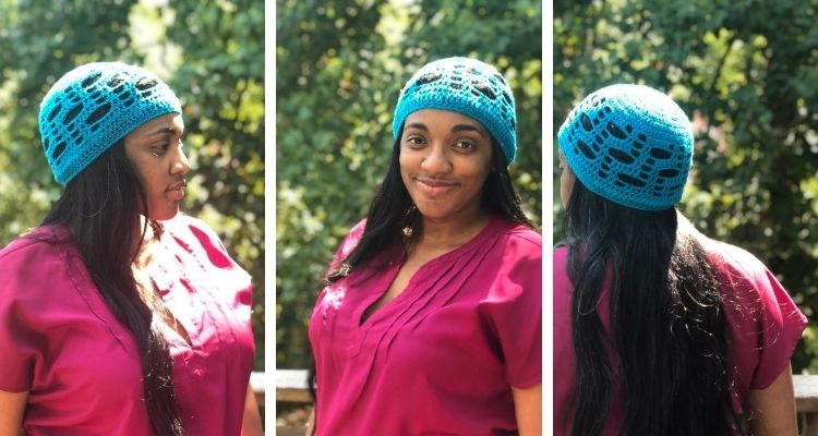 A turquoise crochet hat made of solid and open spaces to resemble a stair case.